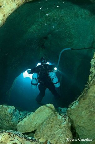 Don Dibble, who is an owner of a dive shop tried to discover the virgin cave areas himself to save future divers from risking themselves into the well